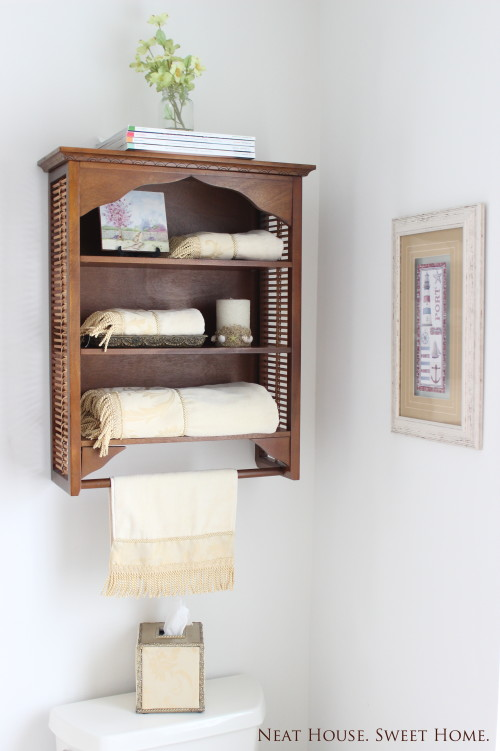 Use wall space in a bathroom to add extra storage.