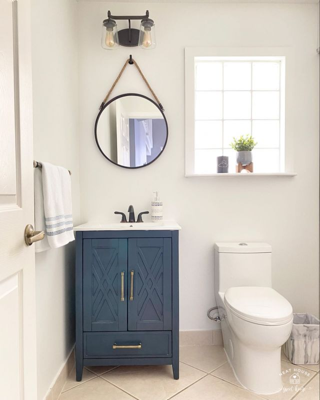🛠 We updated the powder room this summer and I never thought I'd say I love a toilet. 🙈it's modern, flat on the sides, and easy to clean!   Ok, I love the mirror, the light fixture, and the vanity too!   💙 Tap the pic for sources.   #bathroomdesign #bathroomdecor #bathroomremodel #bathroomrenovation #bathroomvanity #bathroominspo #wayfairfinds #kirklands #μαgικμοηδαγ #loweshomeimprovement #lowes #betterhomesandgardens #bhglivebetter #mybhg